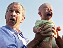 bush holding crying baby