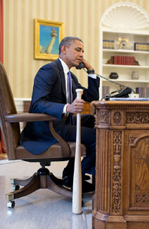 obama with bat in hand