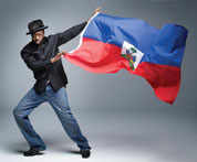wyclef jean with haitian flag